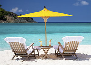 exotic beach with two empty beach chairs