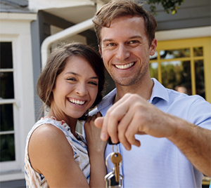 happy smiling couple with new mortgage